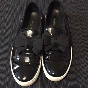 Michael Kors black patent leather slip ons